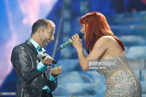 Andrea Berg and DJ Bobo perform live on stage during the Andrea Berg Open Air festival 'Heimspiel' at mechatronik Arena on July 19 2014 in...