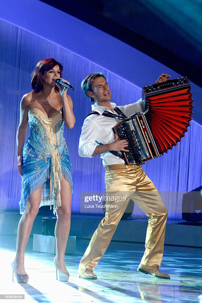 Andrea Berg and Florian Silbereisen perform at 'Das Fruehlingsfest der 100.000 Blueten' TV-Show at GETEC Arena on March 16, 2013 in Magdeburg, Germany.
