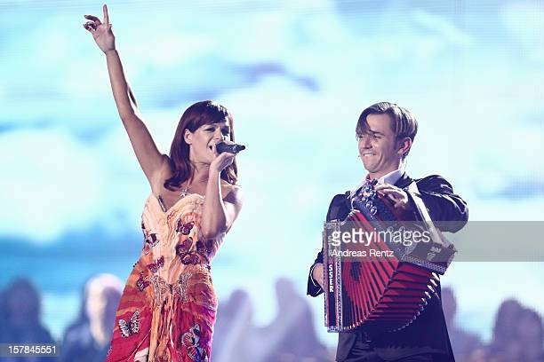 Andrea Berg and Florian Silbereisen perform on stage during the Andrea Berg 'Die 20 Jahre Show' at Baden Arena on December 6, 2012 in Offenburg,...