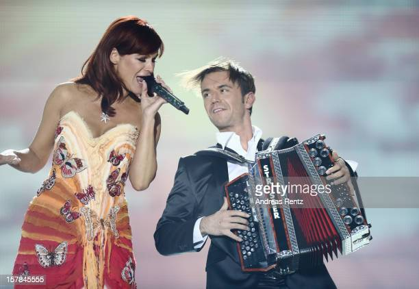 Andrea Berg and Florian Silbereisen perform on stage during the Andrea Berg 'Die 20 Jahre Show' at Baden Arena on December 6 2012 in Offenburg Germany