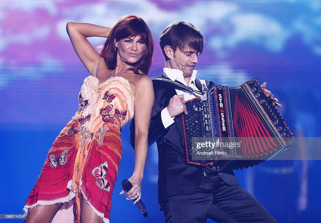 Andrea Berg and Florian Silbereisen perform on stage during the Andrea Berg 'Die 20 Jahre Show' at Baden Arena on December 7, 2012 in Offenburg, Germany.