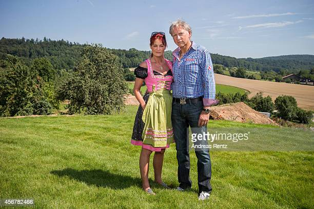 Andrea Berg and her husband Uli Ferber pose for a portrait during the Andrea Berg Open Air festival 'Heimspiel' on July 19, 2014 in Grossaspach,...