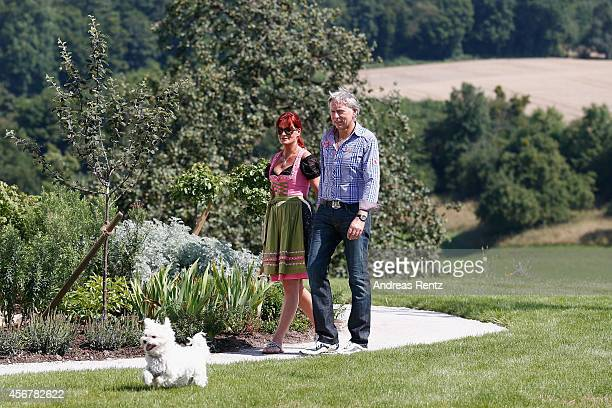 Andrea Berg and her husband Uli Ferber walk prior to the Andrea Berg Open Air festival 'Heimspiel' on July 19 2014 in Grossaspach Germany