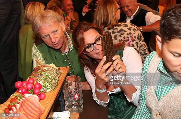 Andrea Berg and her husband Ulrich Ferber make a photo during the opening of the oktoberfest 2016 at the Schottenhamel beer tent at Theresienwiese on...