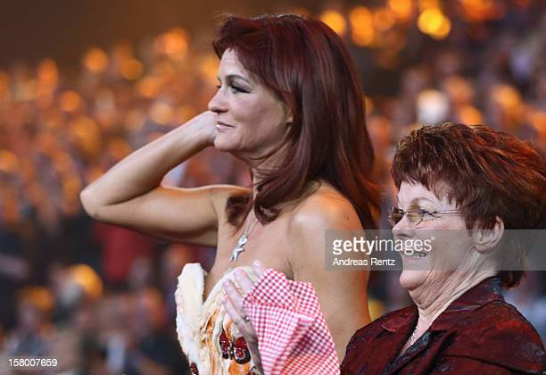Andrea Berg and her mother Helga Zellen gesture during the Andrea Berg 'Die 20 Jahre Show' at Baden Arena on December 7 2012 in Offenburg Germany