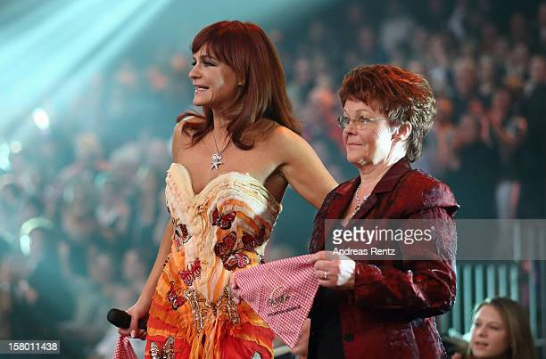 Andrea Berg and her mother Helga Zellen smile during the Andrea Berg 'Die 20 Jahre Show' at Baden Arena on December 7 2012 in Offenburg Germany