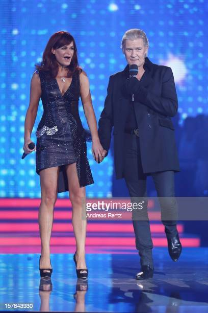 Andrea Berg and Johnny Logan perform on stage during the Andrea Berg 'Die 20 Jahre Show' at Baden Arena on December 6, 2012 in Offenburg, Germany.