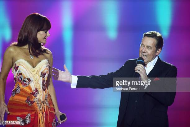 Andrea Berg and Roland Kaiser perform on stage during the Andrea Berg 'Die 20 Jahre Show' at Baden Arena on December 6 2012 in Offenburg Germany