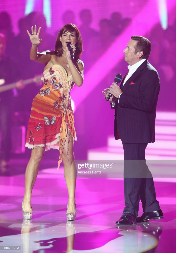 Andrea Berg and Roland Kaiser perform on stage during the Andrea Berg 'Die 20 Jahre Show' at Baden Arena on December 7, 2012 in Offenburg, Germany.