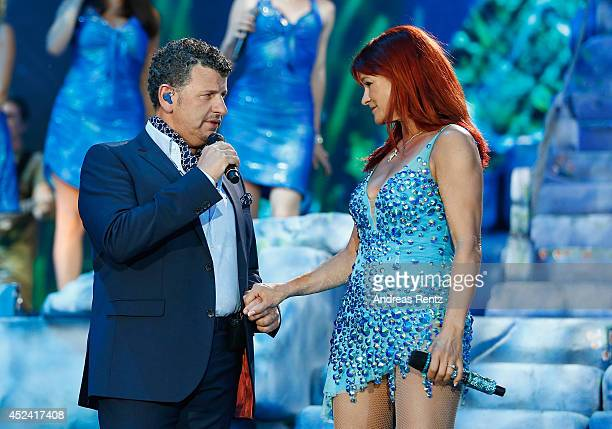 Andrea Berg and Semino Rossi perform live on stage during the Andrea Berg Open Air festival 'Heimspiel' at mechatronik Arena on July 19 2014 in...