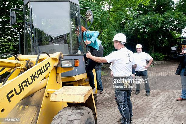 Andrea Berg climb on a excavator at the Stups Children Center for the RTL Charity Marathon on June 13 2012 in Krefeld Germany