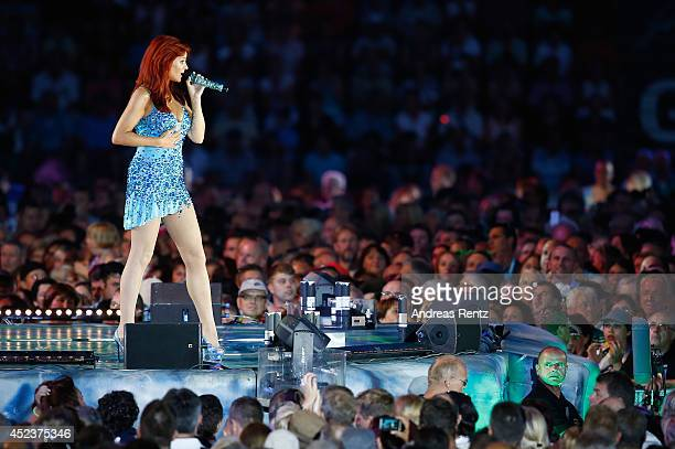 Andrea Berg performs live on stage during the Andrea Berg Open Air festival 'Heimspiel' at mechatronik Arena on July 18 2014 in Grossaspach Germany