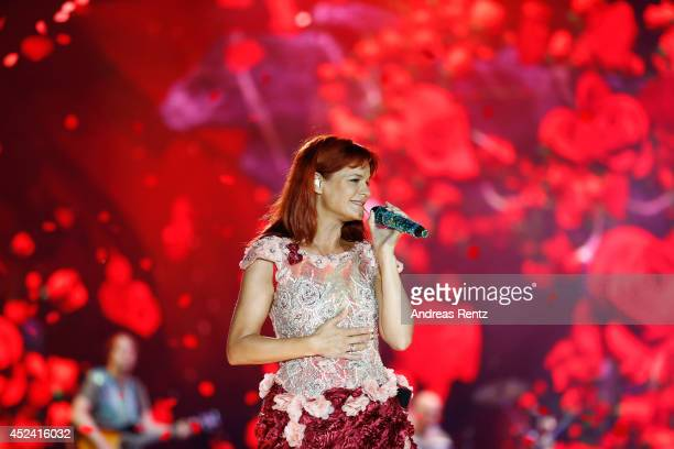 Andrea Berg performs live on stage during the Andrea Berg Open Air festival 'Heimspiel' at mechatronik Arena on July 19 2014 in Grossaspach Germany