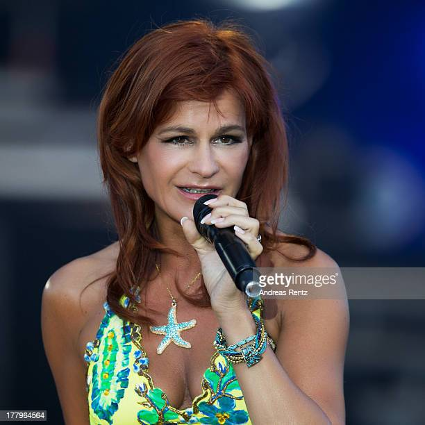 Andrea Berg performs on stage during the Andrea Berg Open Air festival 'Heimspiel' at comtech Arena on July 20, 2013 in Aspach near Stuttagrt,...