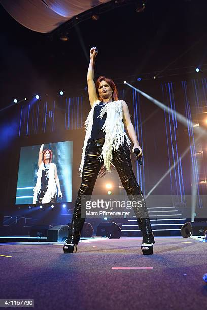 Andrea Berg performs on stage during the 'Schlagernacht des Jahres' at the Lanxess Arena on April 25, 2015 in Cologne, Germany.