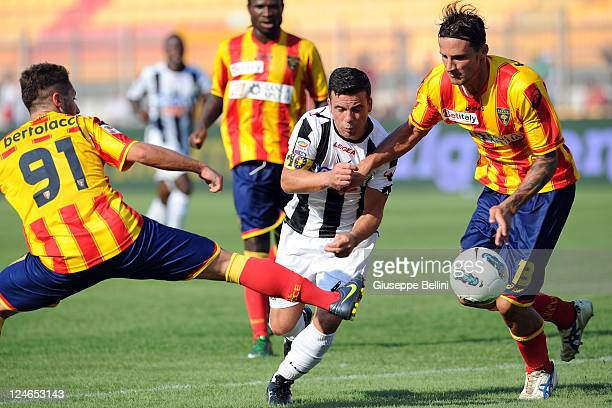 Andrea Bertolacci and Stefano Ferrario of Lecce in action against Antonio Di Natale of Udinese during the Serie A match between US Lecce and Udinese...