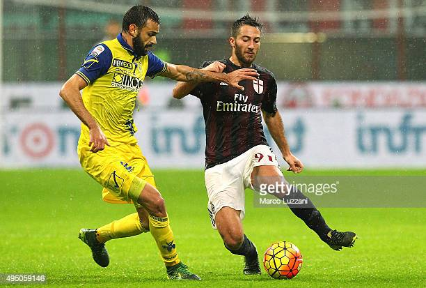 Andrea Bertolacci of AC Milan competes for the ball with Ivan Radovanovic of AC Chievo Verona during the Serie A match between AC Milan and AC Chievo...