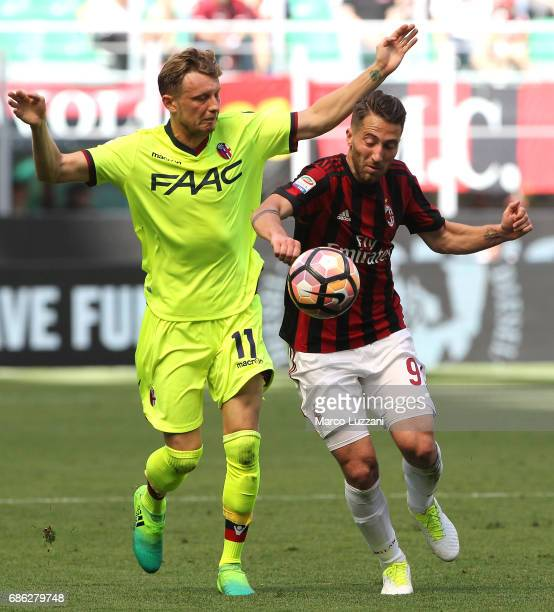 Andrea Bertolacci of AC Milan competes for the ball with Ladislav Krejci of Bologna FC during the Serie A match between AC Milan and Bologna FC at...