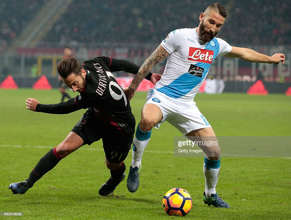 Andrea Bertolacci of AC Milan (L) competes for the ball with Lorenzo Tonelli of SSC Napoli during the Serie A match between AC Milan and SSC Napoli at Stadio Giuseppe Meazza on January 21, 2017 in Milan, Italy.