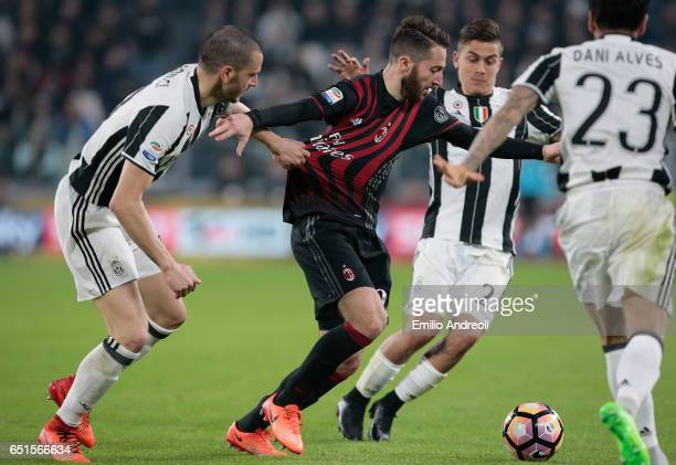 Andrea Bertolacci of AC Milan is pulled by his shirt by Leonardo Bonucci of Juventus FC during the Serie A match between Juventus FC and AC Milan at...