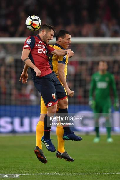 Andrea Bertolacci of Genoa CFC goes up with Romulo of Hellas Verona FC during the Serie A match between Genoa CFC and Hellas Verona FC at Stadio...