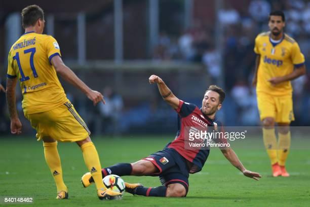 Andrea Bertolacci of Genoa CFC tackles Mario Mandzukic of Juventus during the Serie A match between Genoa CFC and Juventus at Stadio Luigi Ferraris...