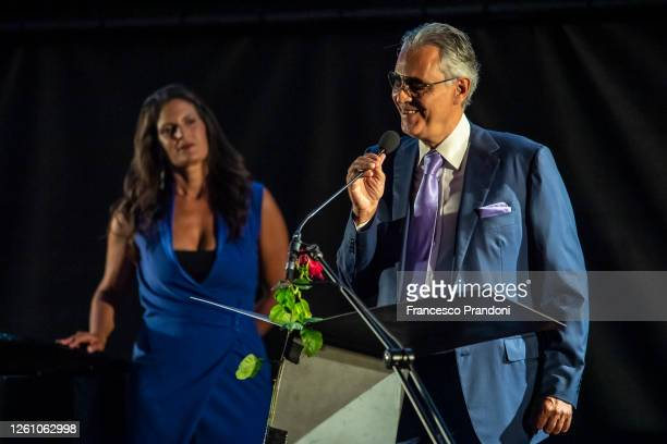 "Andrea Bobelli and his wife Veronica Berti speak during the presentation of the show ""Il Virus Che Ci Rende Folli"" of Bernard- Henry Lévy at the..."