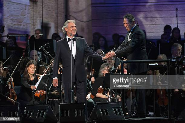 Andrea Bocelli and conductor Eugene Kohn perform at Madison Square Garden on December 9 2015 in New York City