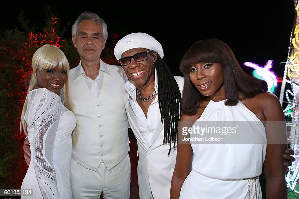 Andrea Bocelli and Nile Rodgers attend a dinner and reception at Andrea Bocelli's country home as part of Celebrity Fight Night Italy benefiting The...