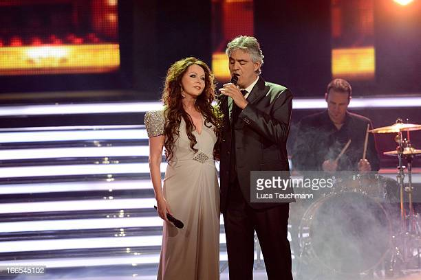 Andrea Bocelli and Sarah Brightman perform during the 'Willkommen bei Carmen Nebel' Show at Messe Erfurt on April 13 2013 in Erfurt Germany