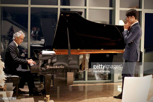 Andrea Bocelli and son Matteo Bocelli break away from the guests for a moment together at the piano during Alfred Mann Foundation's an Evening Under...