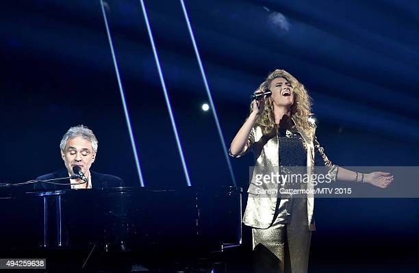 Andrea Bocelli and Tori Kelly perform on stage during the MTV EMA's 2015 at the Mediolanum Forum on October 25 2015 in Milan Italy