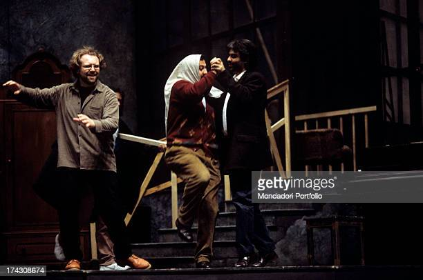 Andrea Bocelli is Rodolfo in Puccini's La Boheme his debut as an opera singer for the Teatro Lirico of Cagliari the tenor is dancing on the stage...