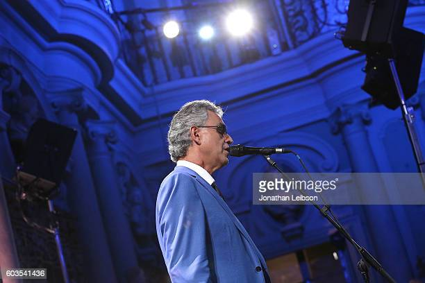 Andrea Bocelli performs at the closing night reception at Salone del Tronoin Palazzo Corsini as part of Celebrity Fight Night Italy Benefiting The...