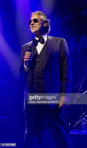 Andrea Bocelli performs during dinner for the amfAR 22nd Annual Cinema Against AIDS Gala at Hotel du CapEdenRoc on May 21 2015 in Cap d'Antibes France
