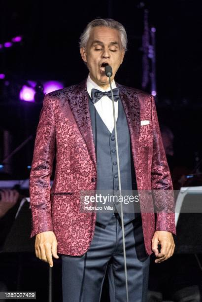 Andrea Bocelli performs on the steps of the Noto Cathedral on October 24, 2020 in Noto, Italy. Andrea Bocelli's concert takes place in Noto, a UNESCO...