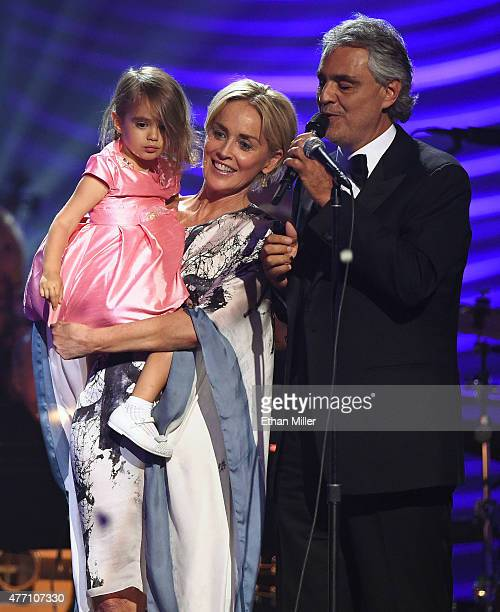 Andrea Bocelli's daughter Virginia Bocelli is held by actress Sharon Stone after honoree Andrea Bocelli performed during the 19th annual Keep Memory...