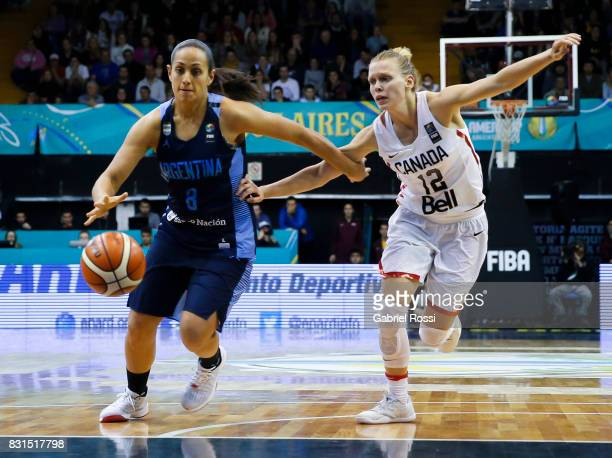 Andrea Boquete of Argentina fights for the ball with Jamie Scott of Canada during a match between Argentina and Canada as part of the FIBA Women's...
