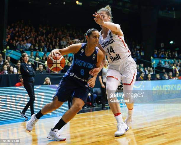 Andrea Boquete of Argentina fights for the ball with Katherine Plouffe of Canada during a match between Argentina and Canada as part of the FIBA...