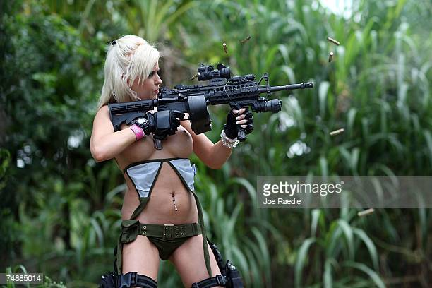 Andrea Brooke Ownbey fires a weapon at a target as she competes against three other women on the set of Girls and Guns a webbased reality show...