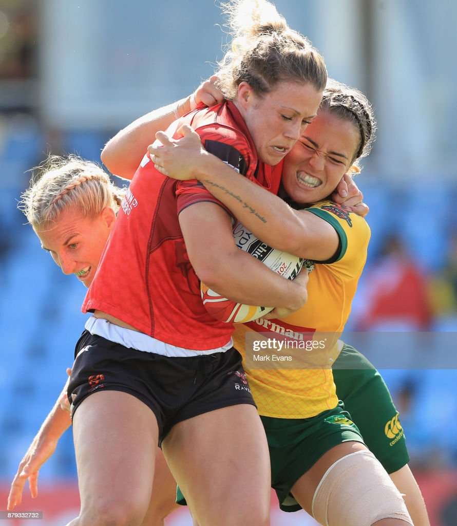 Andrea Burk of Canada is tackled during the 2017 Rugby League World Cup Semi Final match between Australia and Canada at Southern Cross Group Stadium on November 26, 2017 in Sydney, Australia.