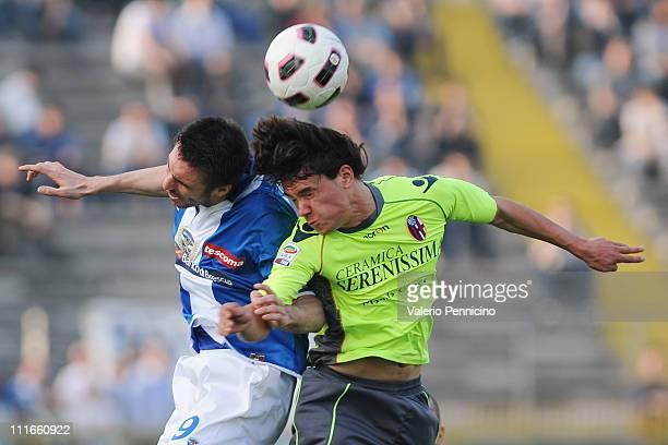 Andrea Caracciolo of Brescia Calcio clashes with Rene Krhin of Bologna FC during the Serie A match between Brescia Calcio and Bologna FC at Mario...