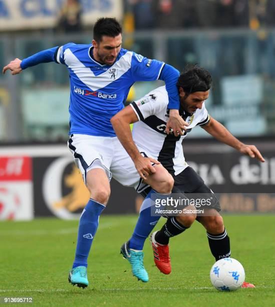 Andrea Caracciolo of Brescia Calcio competes for the ball with Alessandro Lucarelli of Parma Calcio during the Serie B match between Brescia Calcio...