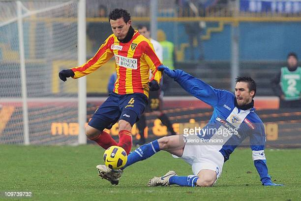 Andrea Caracciolo of Brescia Calcio tackles Gustavo Franchin Schiavolin of Lecce during the Serie A match between Brescia Calcio and Lecce at Mario...