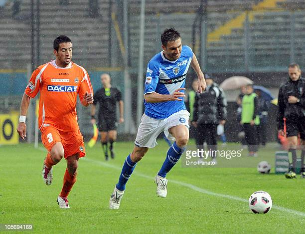 Andrea Caracciolo of Brescia competes with Mauricio Anibal Isla during the Serie A match between Brescia Calcio and Udinese Calcio at Mario Rigamonti...