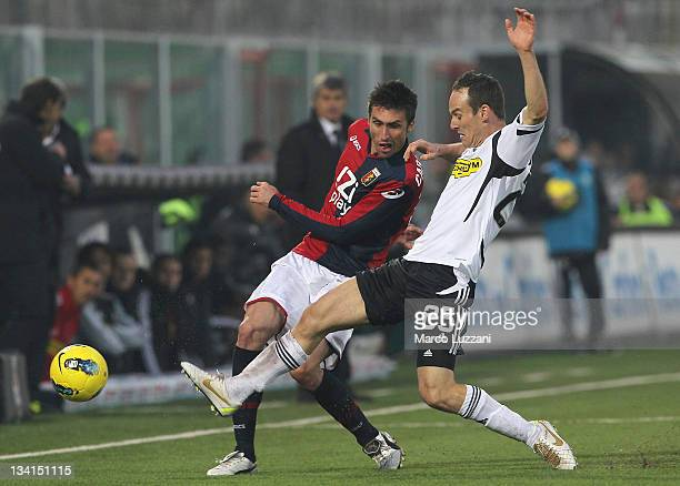 Andrea Caracciolo of Genoa CFC is challenged by Steve Von Bergen of AC Cesena during the Serie A match between AC Cesena and Genoa CFC at Dino...