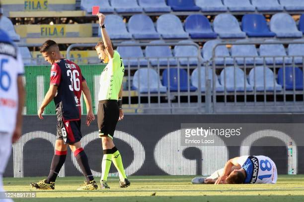 Andrea Carboni of Cagliari receives the red card from the referee during the Serie A match between Cagliari Calcio and Atalanta BC at Sardegna Arena...
