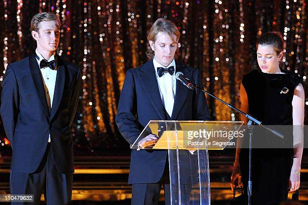 Andrea Casiraghi delivers a speech as Pierre Casiraghi and Charlotte Casiraghi look on during the Monaco Rose Ball 2011 at Sporting Monte Carlo on...