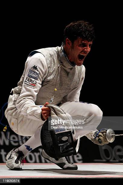Andrea Cassara of Italy celebrates his victory over Andrea Baldini of Italy in the Mens Foil Semi Final during the 2011 European Fencing...