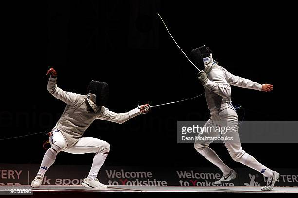 Andrea Cassara of Italy in action against Andrea Baldini of Italy in the Mens Foil Semi Final during the 2011 European Fencing Championships held at...